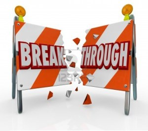 12583692-a-roadblock-barrier-or-barricade-is-split-as-you-break-through-the-obstacle-and-forge-ahead-to-get-w